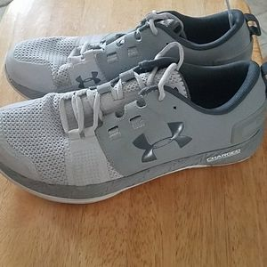 Gray Under Armour tennis shoes